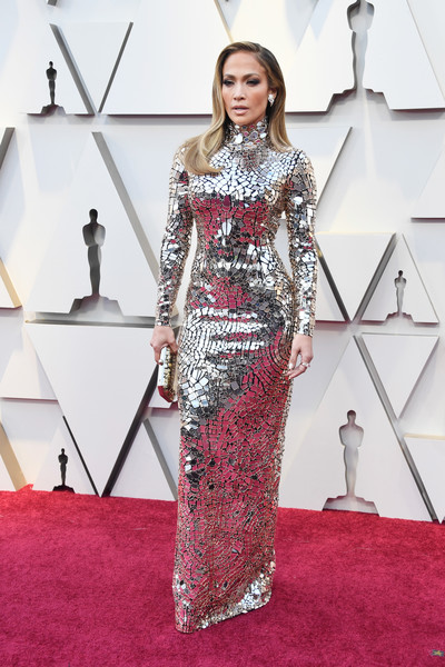 Jennifer Lopez slayed in a mirror-embellished column dress by Tom Ford at the 2019 Oscars.
