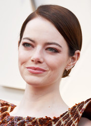 Emma Stone kept it simple and classic with this side-parted chignon at the 2019 Oscars.