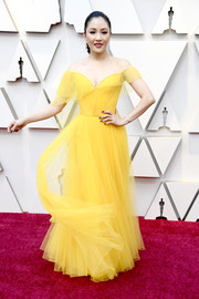 Constance Wu went for classic glamour in a yellow off-the-shoulder tulle gown by Atelier Versace at the 2019 Oscars.