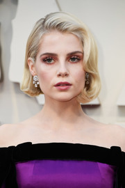 Lucy Boynton styled her hair into a vintage-chic bob for the 2019 Oscars.