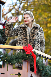 Olivia Holt looked very mature and glam in a leopard-print fur coat during Macy's Thanksgiving Day Parade.