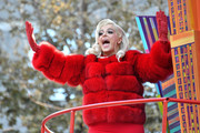 Bebe Rexha teamed red leather gloves with a chic fur coat for her Macy's Thanksgiving Day Parade look.