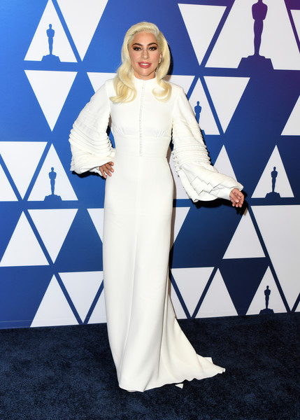 Lady Gaga looked ethereal in a white Louis Vuitton gown with blouson sleeves at the Oscar nominees luncheon.