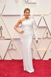 Renee Zellweger went the minimalist route in a white one-shoulder column dress by Armani Privé at the 2020 Oscars.