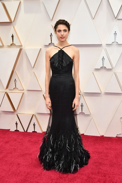 Margaret Qualley charmed in a black feather-hem halter gown by Chanel at the 2020 Oscars.