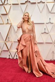 Molly Sims attended the 2020 Oscars wearing a dusty-coral Zuhair Murad gown with a beaded bodice and a ruffled skirt.