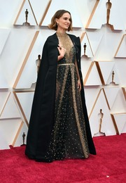 Natalie Portman topped off her dress with a long black cape.