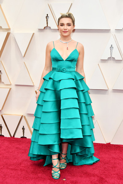 Florence Pugh cut a vibrant figure in a turquoise Louis Vuitton gown with a voluminous tiered skirt at the 2020 Oscars.
