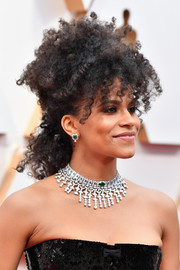 Zazie Beetz styled her wild curls into a half updo for the 2020 Oscars.