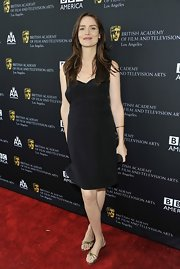 Saffron Burrows kept it casual on the red carpet with gold flat sandals.