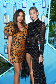 Devon Windsor paired an embroidered leather clutch with a polka-dot dress for the Bombay Sapphire Artisan Series Finale.