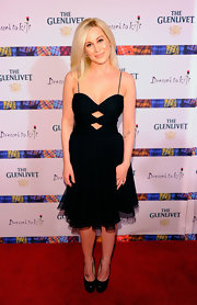 Kellie Pickler paired her flirty black cutout dress with black leather platform pumps.
