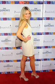 Katrina Bowden delighted in shimmery silver slingback platforms at the Dressed to Kilt Charity Fashion Show.