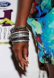 Tichina Arnold made sure she glittered at the Ford Hoodie Awards by piling on the bangles.