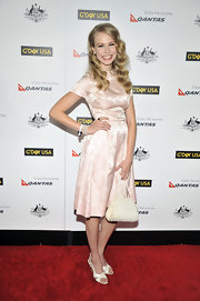 Penelope Mitchell topped off her retro-inspired frock with white sandals.