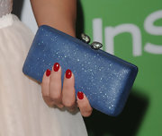 Kelly Brook paired her flirty dress with a sparkling box clutch and a nice manicure to top it off.