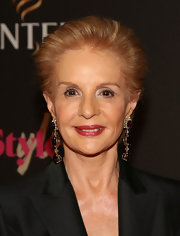 Carolina Herrera topped off her look with her signature short, brushed-back 'do.