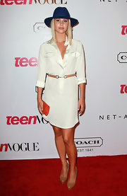 Claire Holt went for a totally preppy red carpet look when she sported this white shirtdress with a clip-style belt.