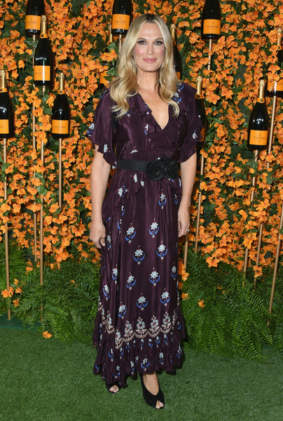Molly Sims looked girly in a ruffled plum print dress by Warm NY at the Veuve Clicquot Polo Classic Los Angeles.