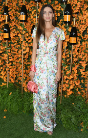Angela Sarafyan amped up the feminine vibe with a coral satin wristlet.