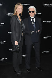 Karl paired his navy suit with a knit scarf.