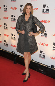 Wendie looked sophisticated in a silver textured evening coat at the Movies for Grownups Awards.