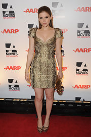 Kate Mara complemented her plunging snakeskin dress with matching peep toe platforms.