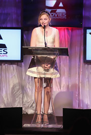Chloe Moretz wore an ivory cocktail dress with sheer inlays for the AARP Awards.