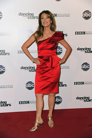 Jane Seymour dazzled in the gold strappy heels she paired with an equally eye catching crimson cocktail dress. It's hard to believe the stunning actress is 59!