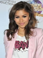 Zendaya opted for a soft and feminine beauty look such as this blush pink lipstick to contrast her menswear-inspired suit.