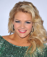 Witney Carson kept her red carpet look big and bold with a thick and curly hairstyle.