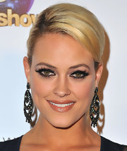 Peta Murgatroyd looked elegant on the red carpet with a side-parted ponytail.