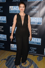 Bellamy Young brings the scandal to the red carpet in this sheer black jumpsuit with a plunging V-neck