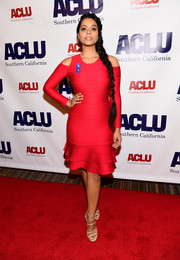 Lilly Singh flaunted her figure in a red cold-shoulder bandage dress by Shoshanna at the Bill of Rights dinner.