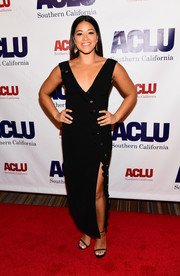 Gina Rodriguez went bold in a form-fitting black dress with a deep-V neckline and a high side slit at the Bill of Rights dinner.