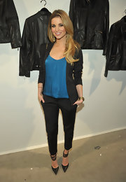 Amber Lancaster looked edgy in black pointy toe pumps with sexy ankle straps. She paired the heels with a silk turquoise tank and black blazer.