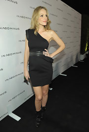 Monet Mazur rocked black mid-calf boots with a one shoulder LBD. Leather detailing completes her cool chic look.