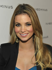 Amber Lancaster showed off her long lustrous curls while attending a store launch in LA.