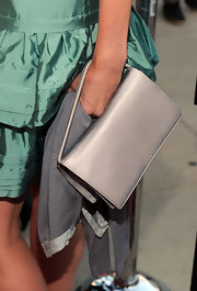 Mira Sorvino paired a simple yet classy silver satin purse with her teal cocktail dress at the 'Get Low' premiere.
