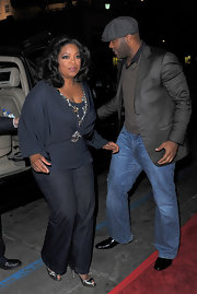 Oprah Winfrey paired charcoal slacks with a draped blouse for her chic red carpet look during the screening of 'Precious.'