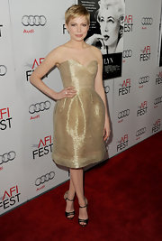 Michelle Williams shined on the red carpet at the 'My Week With Marilyn' screening at the AFI Fest. She topped off her look with black strappy sandals with gold detailing.