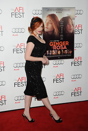 Christina Hendricks' strappy sandals were an elegant addition to her glistening dress.