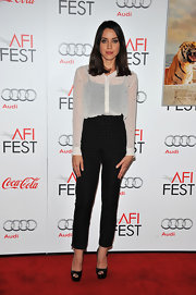 Aubrey Plaza made her legs look longer with a pair of platform peep-toes teamed with high-waist pants.