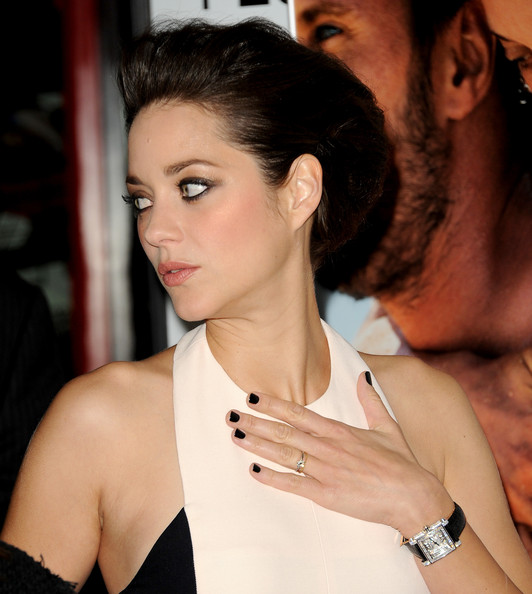 Marion Cotillard's white diamond timepiece was set in 18-carat white gold and featured a square face and black crocodile band—very elegant, no?