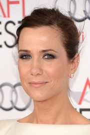 Kristen Wiig sported a simple side-parted bun at the screening of 'The Secret Life of Walter Mitty.'