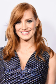 Jessica Chastain sported a gently wavy hairstyle with side-swept bangs at the premiere of 'A Most Violent Year.'