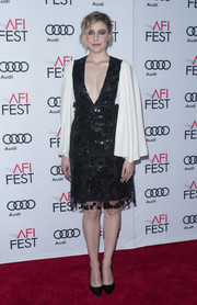 Greta Gerwig donned a black-and-white Rodarte sequin dress with a plunging neckline and voluminous sleeves for the AFI Fest tribute to Annette Bening.