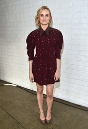 Tan pumps with gold ankle straps finished off Diane Kruger's look.