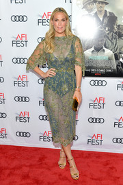 Molly Sims was one hot mama in a sheer floral-embroidered dress by Luisa Beccaria at the AFI FEST 2017 opening night gala.