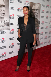 Zoe Saldana went for ultra-elegant styling with a crystal-embellished velvet clutch by Roger Vivier.
